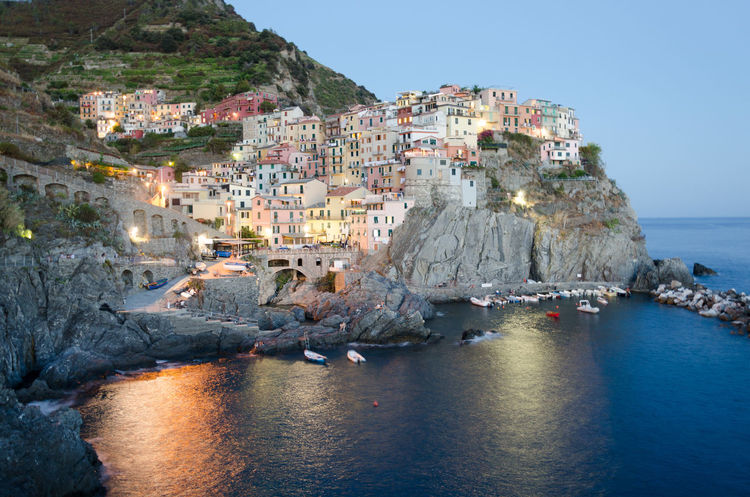 Night view of the cliff of Manarola Cinqueterre Italy Cinque Terre City Italia Landscape_Collection Liguria,Italy Manarola, Cinqueterre Architecture Cinque Terre Liguria Cinqueterre Clear Sky Cliff Italiancity Italy Italy❤️ Landscape Liguria Manarola Outdoors Rock - Object Travel Destinations Water Waterfront Paint The Town Yellow