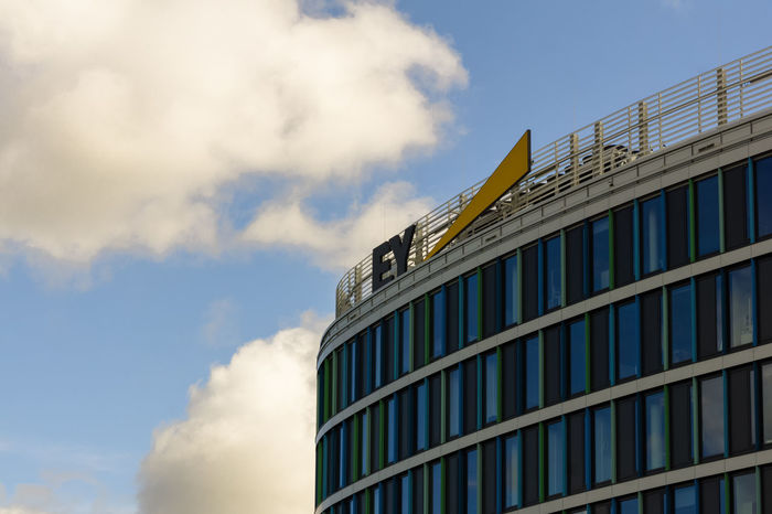 LEINFELDEN-ECHTERDINGEN,GERMANY - SEPTEMBER 10,2017: Ernst & Young The building of the company is in Flughafenstrasse.It offers financial and accounting services. Baden-Württemberg  Colors Building Clouds Color Ernst & Young Europe Germany Leinfelden-echterdingen Sky Windows