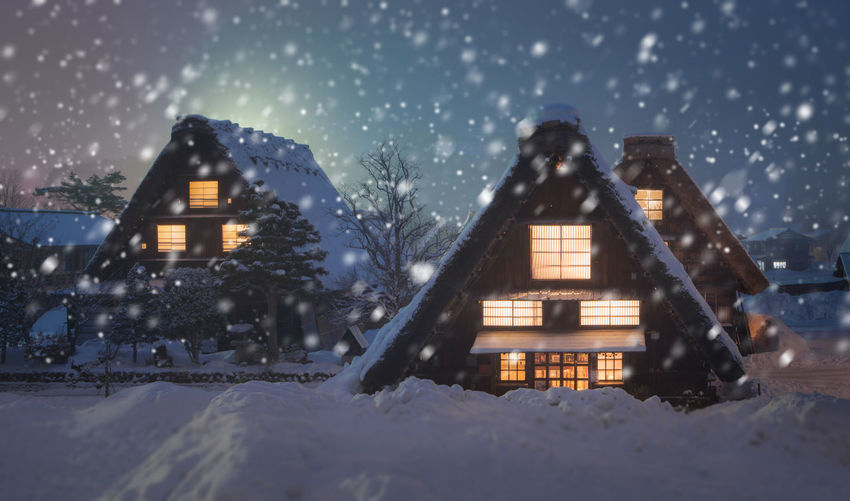 Shirakawago with Snowfall, Japan Snow Cold Temperature Winter Architecture Building Exterior Built Structure Snowing Building Tree Nature Illuminated House Night Dusk No People Celebration Frozen Outdoors Scenics - Nature Extreme Weather Blizzard