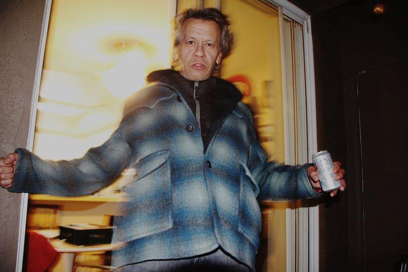 Portrait of man standing against doorway