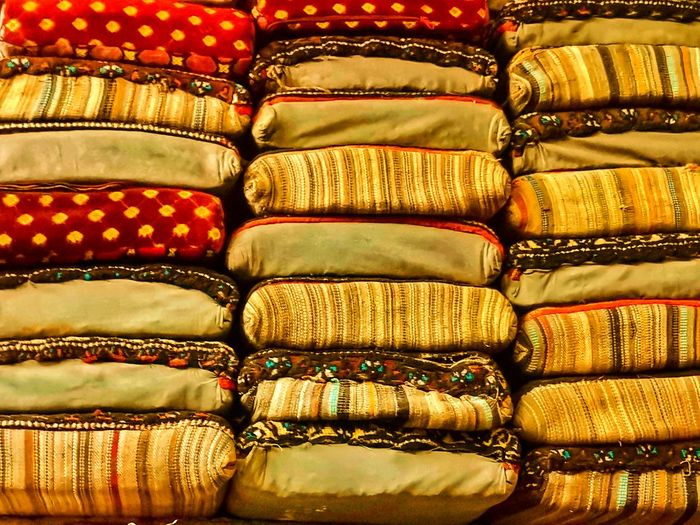 Full frame shot of multi colored pillows for sale in store