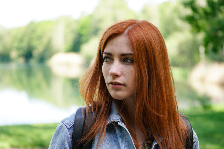 Close-up of young woman with redhead