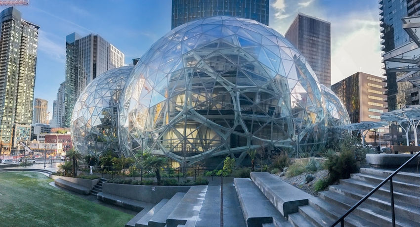 Amazon world headquarters spheres in downtown Seattle circa January 2018. Editorial featuring campus lawn, steps and surrounding towers. Panorama Architecture Business Campus Condominiums Downtown Jeff Bezos Offices Panorama Seattle Skyline Washington Amazon Design Engineering Finance Green Houses Headquarters Housing Lawn Office Towers Real Estate Software Spheres Wealth World