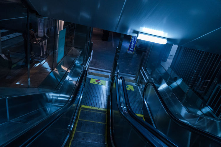 Japan Architecture Built Structure City City Life Direction Futuristic Illuminated Indoors  Modern Neon Night No People Parking Garage Staircase Steps And Staircases Technology Transportation
