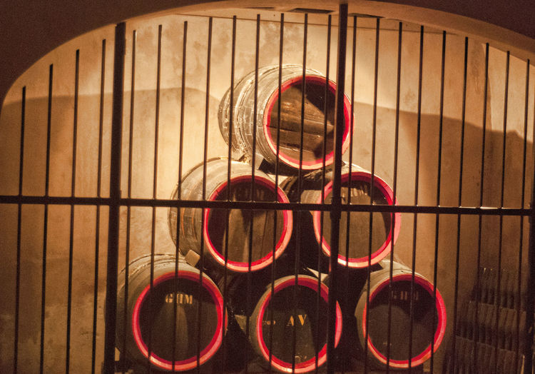 Wine Barrels Close-up Day Indoors  No People Wine Barrels Stacked Wine Behind Bars Wine Cellar, Wine Bottles, Stacked, Aging, Glass, Drink, Alcohol, Wine Locked Up