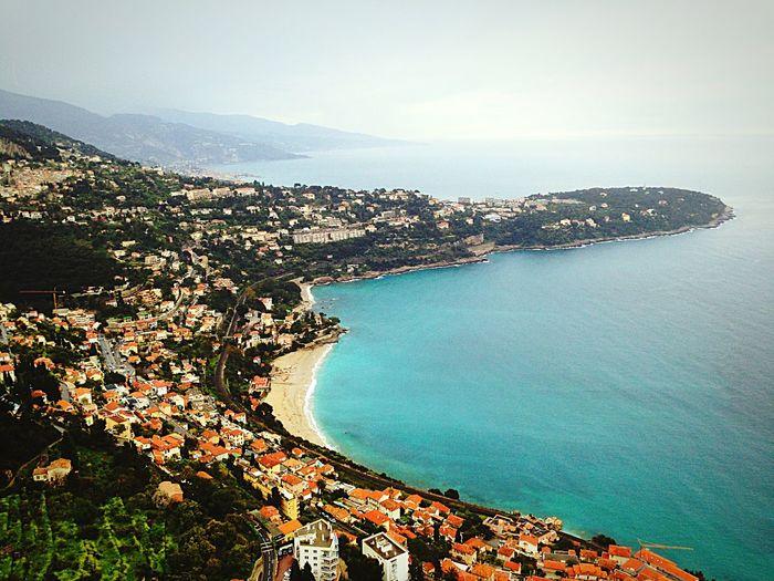 High Angle Shot Of Town Against Calm Blue Sea
