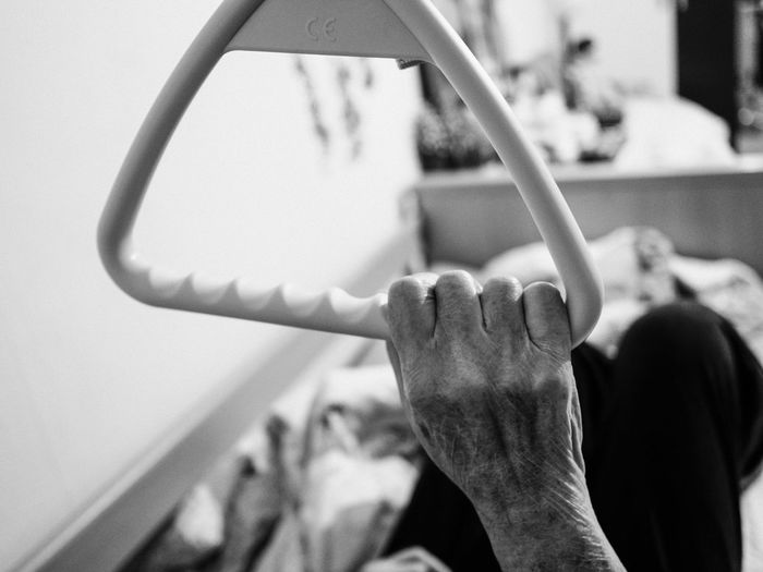 Cropped hand of senior person holding handle at home