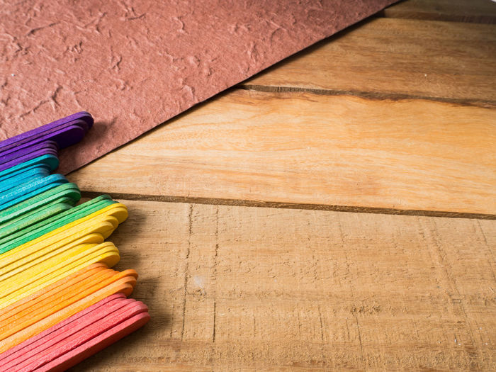 Close-Up Of Multi Colored Popsicle Sticks On Table