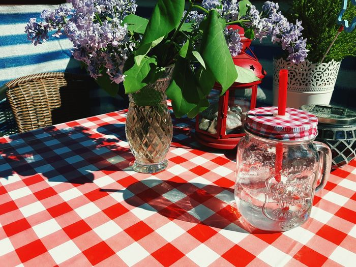 Summer table Checked Pattern Table Tablecloth Vase No People Day Nature Freshness Weekend Picnic Glass Mug Terrace Glass Jars On The Table Glass Jar Pattern Pieces Patterns Lunch Time! Summer Lunch  Travel Destinations Holidays Vacations Lato Stół Outdoors Pattern