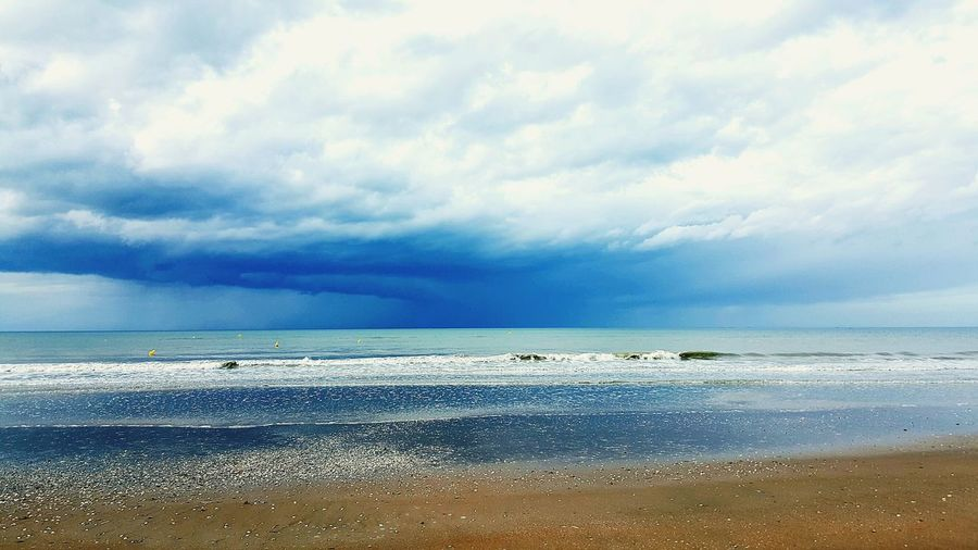 Water Reflections France Sea Sea And Sky Vacations Plage Cabourg  Plage De Cabourg ✨ French France Normandie Calvadosnormandie Water Sea Beach Flamingo Sky Horizon Over Water Animal Themes Cloud - Sky Landscape