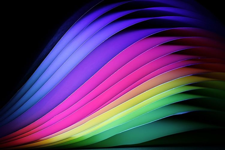 Close-up of colorful color swatches against black background