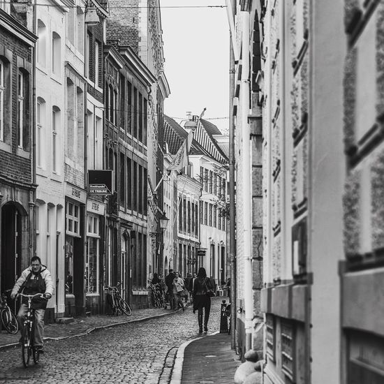 Architecture Bicycle Building Exterior Built Structure Street Cycling City Outdoors Transportation Real People Walking Day Men Women Group Of People Large Group Of People People Sky Adult Adults Only