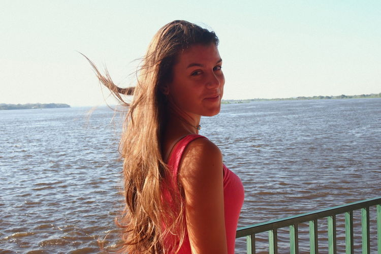 Beach Beautiful Woman Close-up Day Horizon Over Water Latina Leisure Activity Lifestyles Long Hair Nature One Person Outdoors Portrait Real People River Sea Smile Traveler Vacations Waist Up Water Young Adult Young Women