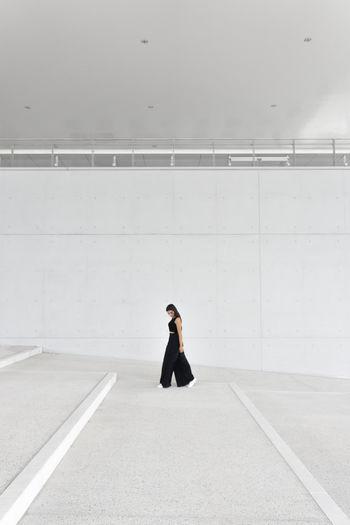 Full Length Of Woman Walking In Basement