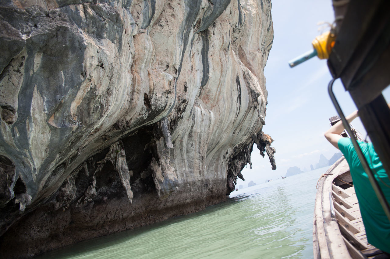 Huge Rock On Lake Against Sky