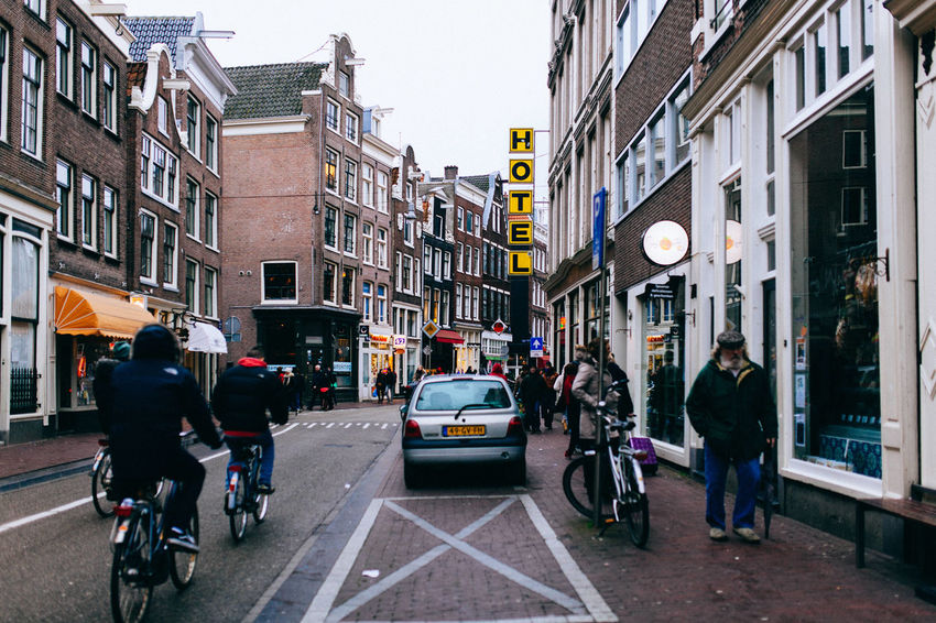 A Wintery Amsterdam... All Streets Amsterdam Architecture Bicycle Building Exterior Built Structure Car City City Life City Street Full Length Land Vehicle Men Mode Of Transport On The Move Person Riding Road Street Transportation Walking Your Amsterdam Your Ticket To Europe