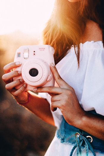 Pink One Person Photography Themes Human Hand Women Real People Photographing Camera - Photographic Equipment Day Indoors  Close-up Adult Young Adult Adults Only People