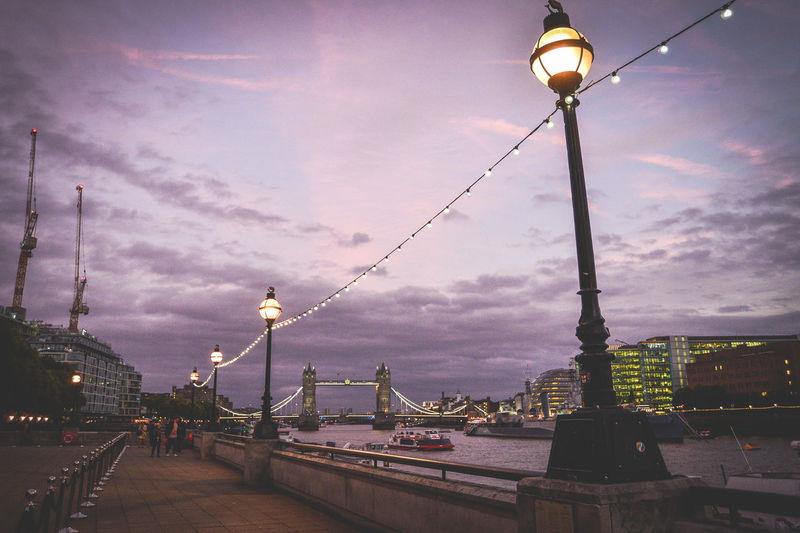 Street lights in city at dusk