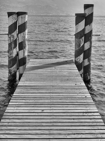 Art, Drawing, Creativity Beach Beauty In Nature Black & White Black And White Blackandwhite Day EyeEm Best Shots EyeEm Gallery Lake Lake View Nature Nautical Vessel No People Outdoors Personal Perspective Pier Poster Sea The Week Of Eyeem Tranquil Scene Tranquility Water Wave Wood Paneling