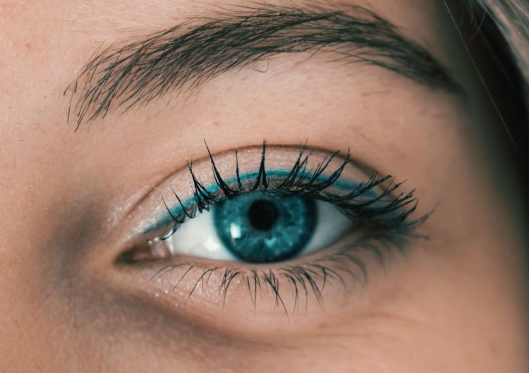 Close-up of teenage girl eye with eyeshadow