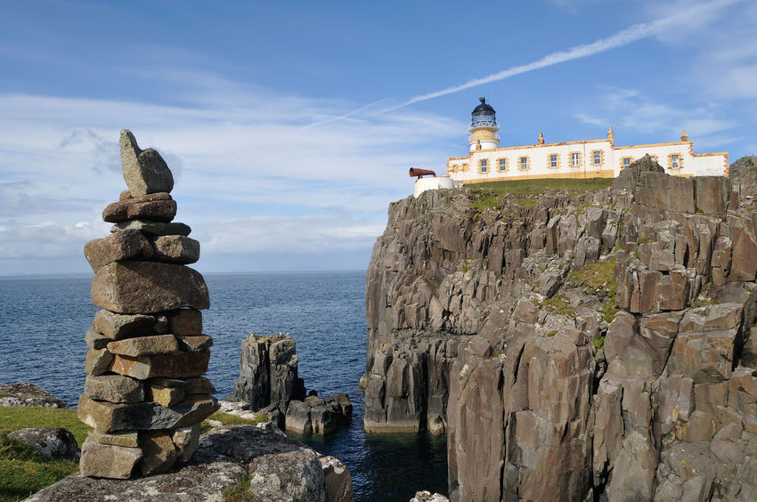 Cairns perched on the clifftop opposite Neist Point lighthouse, Isle of Skye Beauty In Nature Blue Cairn Cliffs Cloud - Sky Coast Highlands Horizon Over Water Lighthouse Neist Point Neist Point Lighthouse No People Outdoors Rock Rock - Object Rock Formation Scenics Scotland Sea Sky Skye