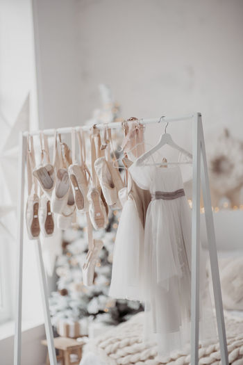 Close-up of clothes hanging on glass