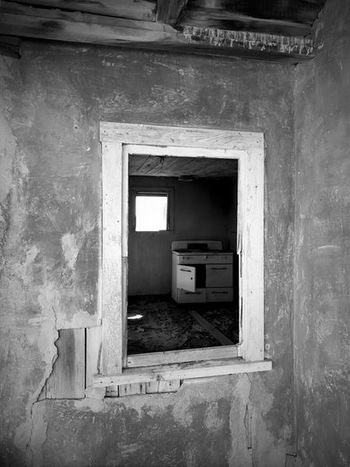 """""""Once Upon A Time In Cedarvale No. 2"""" Where Mother cooked. Blackandwhite Photography Black & White Black And White Blackandwhite New Mexico Photography New Mexico Abandoned Buildings Abandoned Places Abandoned Kitchen Stove Weathered Window Frame Kitchen Window View Architecture Built Structure Window House Abandoned"""