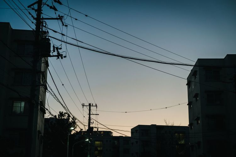 Sky Cable Built Structure Architecture Building Exterior Electricity  Technology Sunset Building City Fuel And Power Generation Power Line  Nature Low Angle View No People Power Supply Connection Electricity Pylon Clear Sky Silhouette
