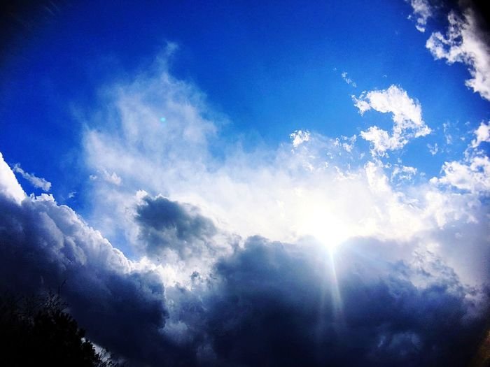 Shot while waiting for the weather to change for a shoot. Blue Beauty In Nature Nature Sky Sunbeam Tranquility Sunlight Day Low Angle View No People Scenics Cloud - Sky Tranquil Scene Outdoors