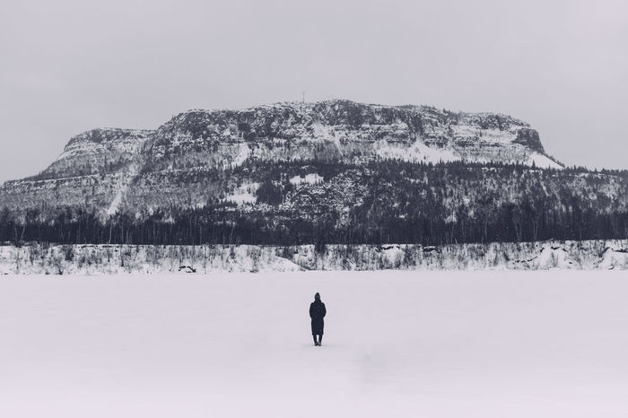 Winter Woman Mountain Frozen Lake Winter Scene Dark Figure Centered Composition Mount McKay Finding New Frontiers