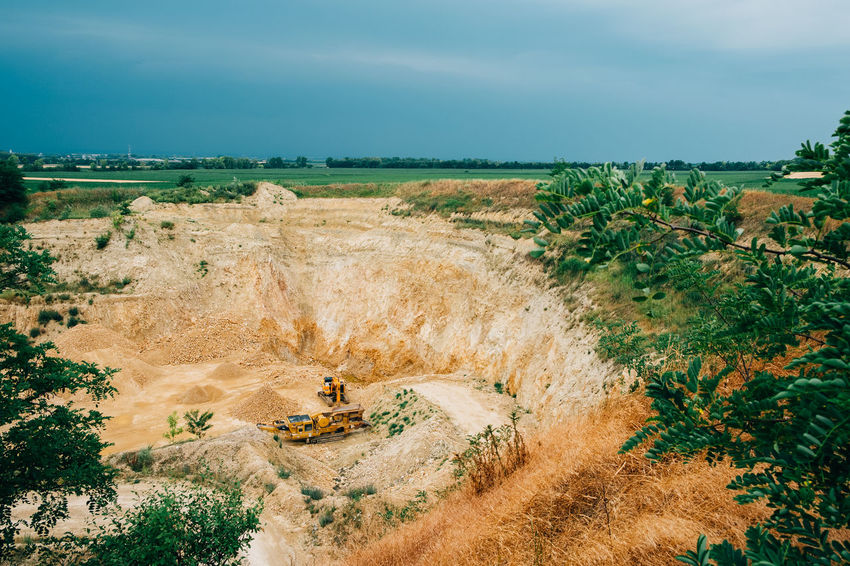 Minerals Beauty In Nature Cloud - Sky Day Environment Field Geology High Angle View Industry Land Landscape Mine No People Non-urban Scene Outdoors Plant Quarry Sky Stone Surface Mine Tranquil Scene Tranquility Transportation Truck Vehicle