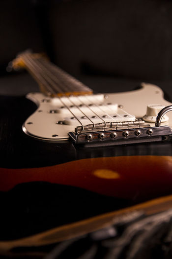 Music Musical Instrument Arts Culture And Entertainment Guitar Musical Equipment String Instrument String Indoors  Musical Instrument String Selective Focus Electric Guitar Black Background Close-up Studio Shot No People Wood - Material Still Life Modern Rock Fretboard Rock Music Nightlife Bass Guitar