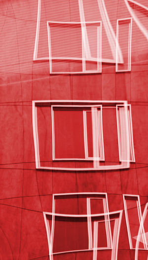 I saw this reflection of a building which made the windows appear to multiply and warp in a Picasso-esque style Architecture Artistic Building Calgary Day Design Geometry Modern Multiply Pattern Picasso Style Portrait Format Red Warp Windows Art Is Everywhere The Architect - 2017 EyeEm Awards