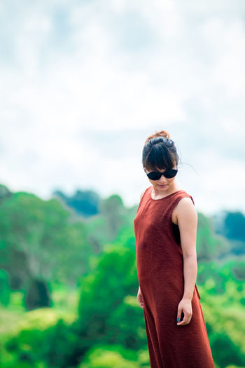 Japanese Girl Poses for Picture in Gold Coast, Australia One Person Outdoors Australia Asian  Travel Destinations Pose Model Females Nature Tree Freshness Airplane Road Back Packer Landscape Sunglasses Girl Green Brown Cloud - Sky Sky Hitchhiking Lifestyles Mountain People