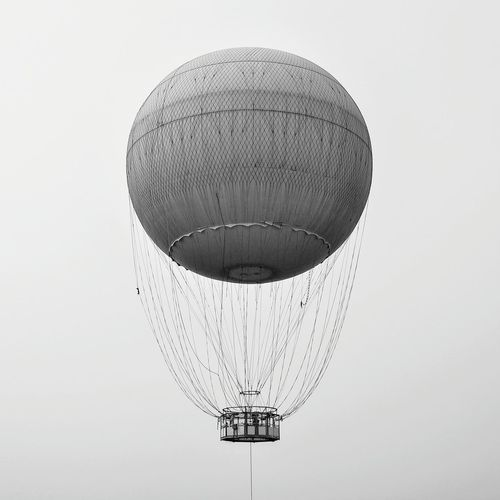 Low angle view of hot air balloon flying against clear sky
