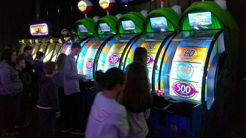 Store Retail  Waist Up Multi Colored People Consumerism Customer  Men Indoors  Arcade Games Playing Arcade Arcade Game Arcade Machine