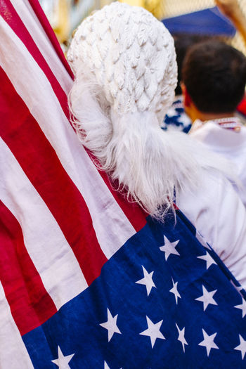 Rear view of person with american flag at event