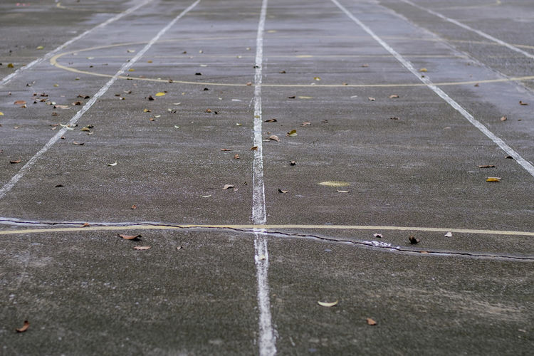 Yellow line running track Runway Running Day No People High Angle View Sport Outdoors Road Direction Transportation The Way Forward Concrete Pattern City Marking Full Frame Competitive Sport Gray Street Nature Symbol