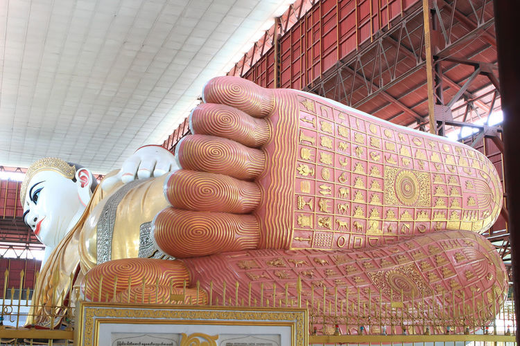 The giant reclining Buddha at Chaukhtatgyi temple in Yangon, Myanma Myanma BIG Chaukhtatgyi Buddha, Yangon The Giant Yangon Yangon, Myanmar Architecture Art And Craft Belief Building Built Structure Ceiling Craft Creativity Day Finger Focus On Foreground Hand Human Representation Indoors  Male Likeness Place Of Worship Religion Representation Sculpture Spirituality Statue