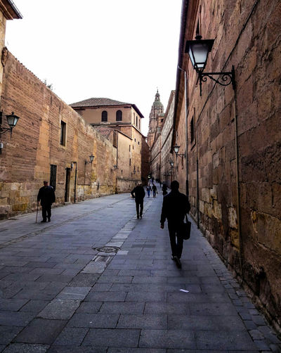 Walking the Streets of Salamanca, Spain. People Walking  the Cobblestone Streets Of Spain Outsideof the Universidad De Salamanca. Old Buildings Line The Streets . Old Structures, Old Architecture Streetphotography Ronlouisphotos Europe