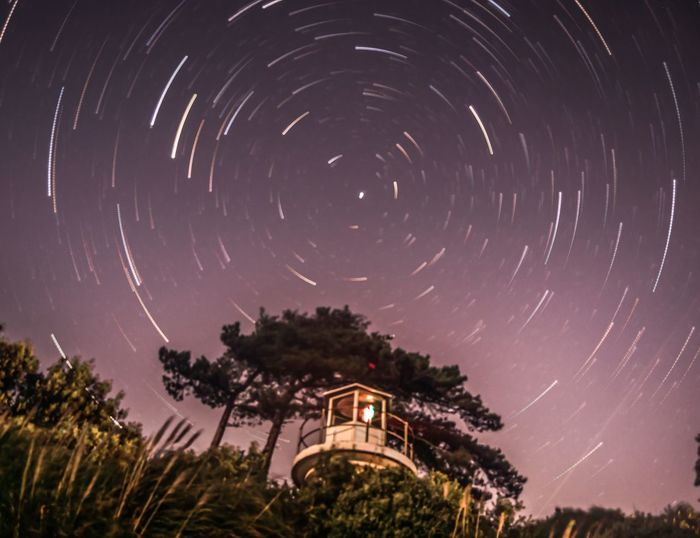 star trails at Lepe beach #startrails #longexposure #nikon #d3100 #newforest #lighthouse Galaxy Star Trail Space Concentric Tree Star - Space Constellation Milky Way Motion Astrology First Eyeem Photo