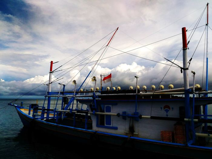 The journey to your destination often be a life changing experience. Reflection Sky Water Cloud - Sky Nautical Vessel Flag No People Sea Waterfront Harbor Patriotism Outdoors Day Light And Reflection EyeEm Best Shots Lifestyles Lifestyle ToTravelIsToLearn Travel EyeEm Indonesia EyeEm Gallery Eyeemweekly EyeEm Vision EyeEm Colors Of Life