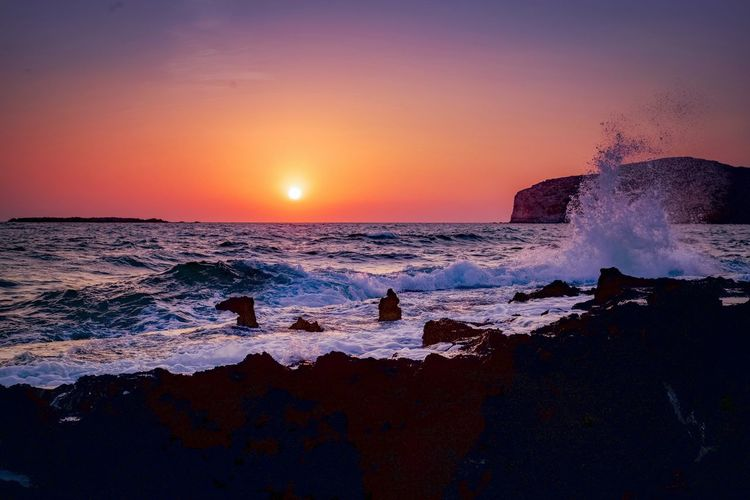 Falassarna Beach, Crete, Greece. Ocean View EyeEm Best Shots EyeEm Nature Lover Water Sky Sea Sunset Beauty In Nature Scenics - Nature Motion Horizon Over Water Orange Color Horizon Beach Splashing Power In Nature Rock - Object Nature Wave Land