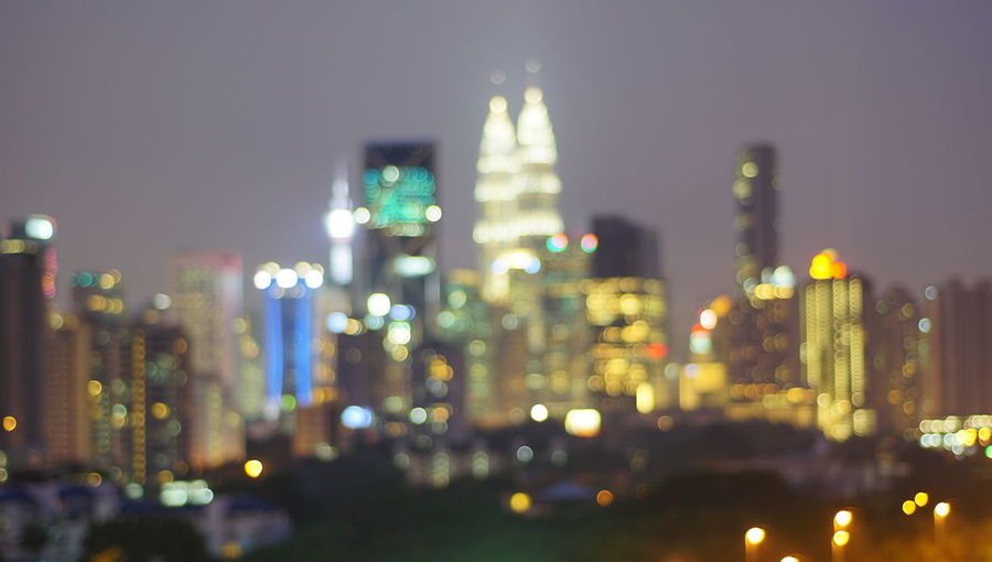 Malaysia city skyline illuminated at night.Blurry photo light and bokeh. Architecture Building Building Exterior Built Structure City City Life Cityscape Defocused Financial District  Glowing Illuminated Night No People Office Building Exterior Outdoors Residential District Sky Skyscraper Tall - High Travel Destinations