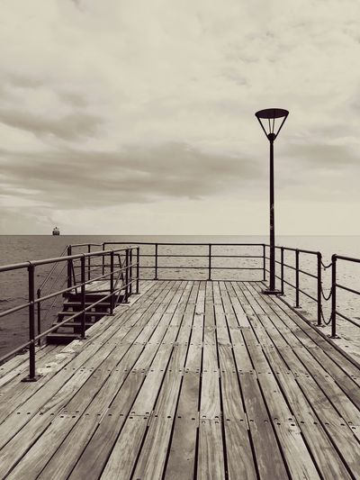 Wooden Boat Ship Art Shapes Lines Clouds Light EyeEm Selects Sky Wood - Material Railing Cloud - Sky Pier Nature Sea Water The Way Forward Scenics - Nature Direction Built Structure Tranquil Scene Outdoors No People Tranquility Wood Day Architecture Street Light