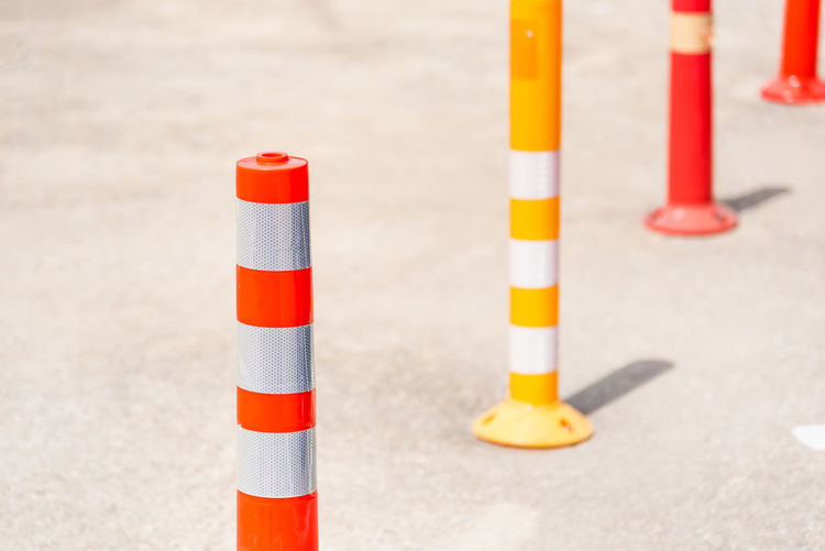 Close-up of traffic cones on road