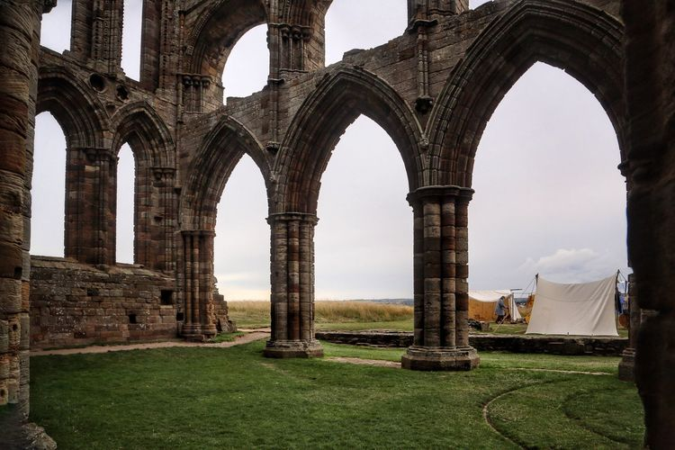 Whitby Whitby Whitby Abbey Architecture Arch Built Structure History The Past Grass Sky Nature Travel Architectural Column Old Ruin Ancient Travel Destinations Day Building Exterior Old Tourism No People Building Outdoors Abbey Ancient Civilization Ruined Archaeology Colonnade