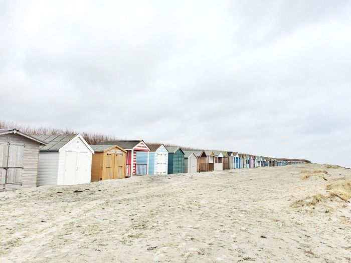 Beach Houses, West Wittering Beach, Chichester, England, First Eyeem Photo Beach Huts Beach Beach House Sand Walking Around Grey Sky Huts Fresh On Eyeem  Market Bestsellers 2017
