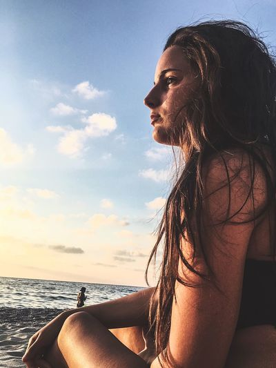 Live For The Story Young Adult Sea Young Women One Person Real People Leisure Activity Cloud - Sky Beach Lifestyles Sky Beautiful Woman Water Nature Beauty In Nature Outdoors Day Horizon Over Water Portrait Close-up People