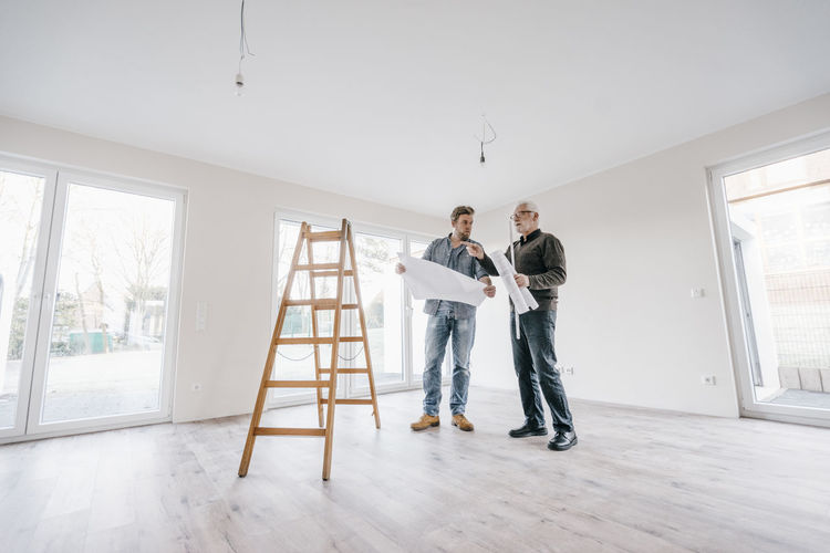 Men standing at home
